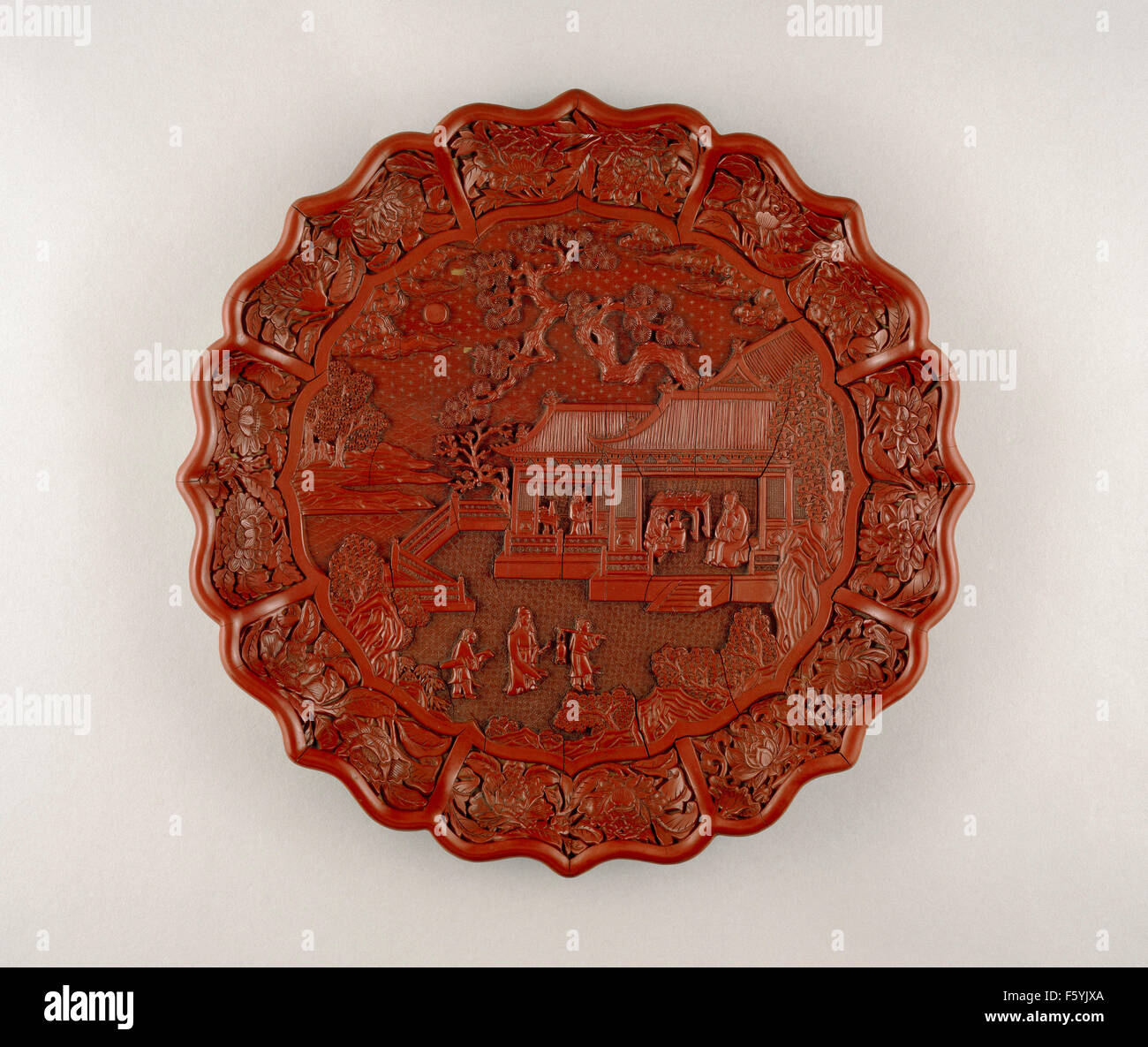 Carved red lacquer on wood core, Yongle mark and period 1403-24, South China. Diameter 34.8 cm © The Trustees - Stock Image