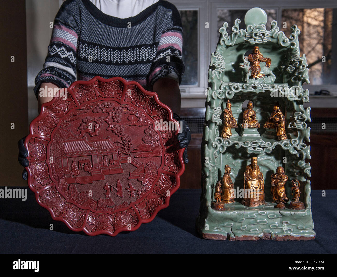 The objects featured :  -carved red lacquer on wood core  1403-24 features scenes of Imperial Household 35 cm diameter. - Stock Image