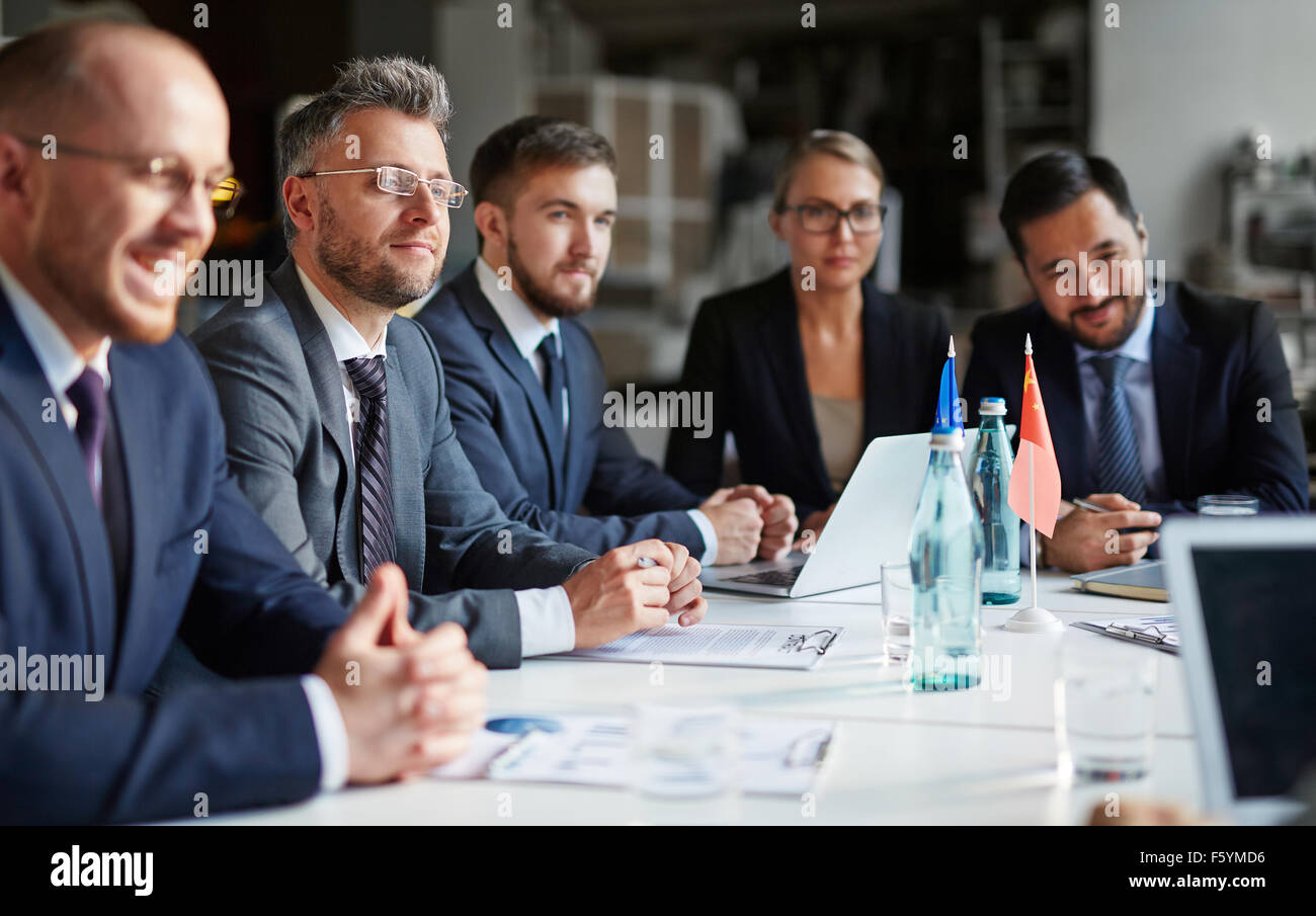 Business group of people attending and listening at conference - Stock Image