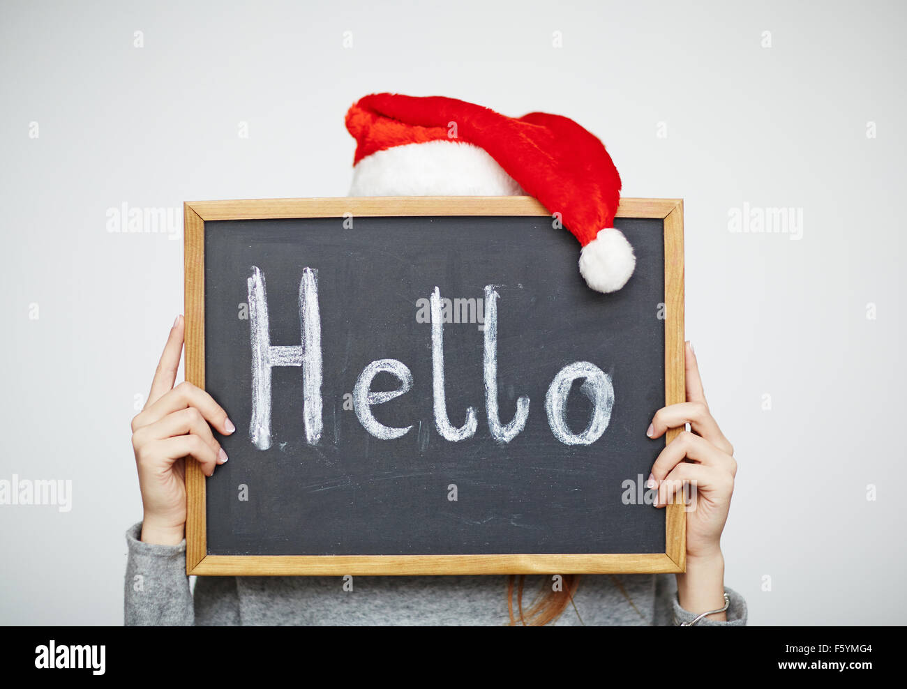 Small blackboard with Hello held by female - Stock Image