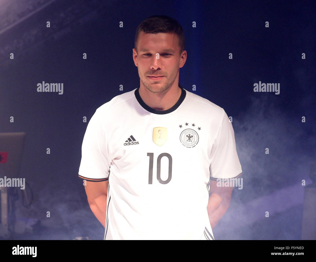 750e9ae0f9a German national soccer players Lukas Podolski (C) poses during the  presentation of the German national soccer team kit for the UEFA Euro 2016  provided by ...