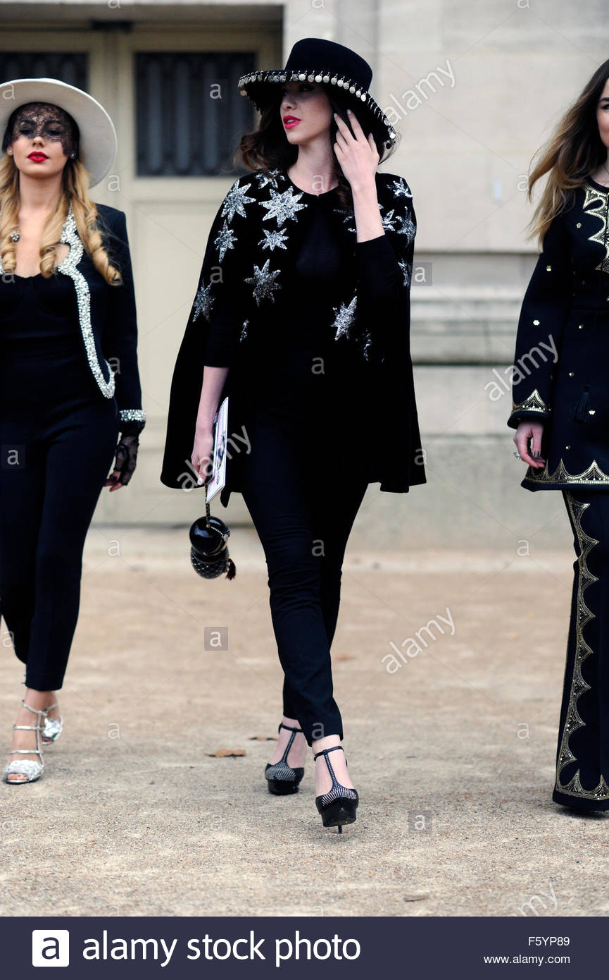 Woman Arrive for Chanel Ready To Wear Fashion Show  at the Grand Palais, Paris Fashion Week 2015. - Stock Image