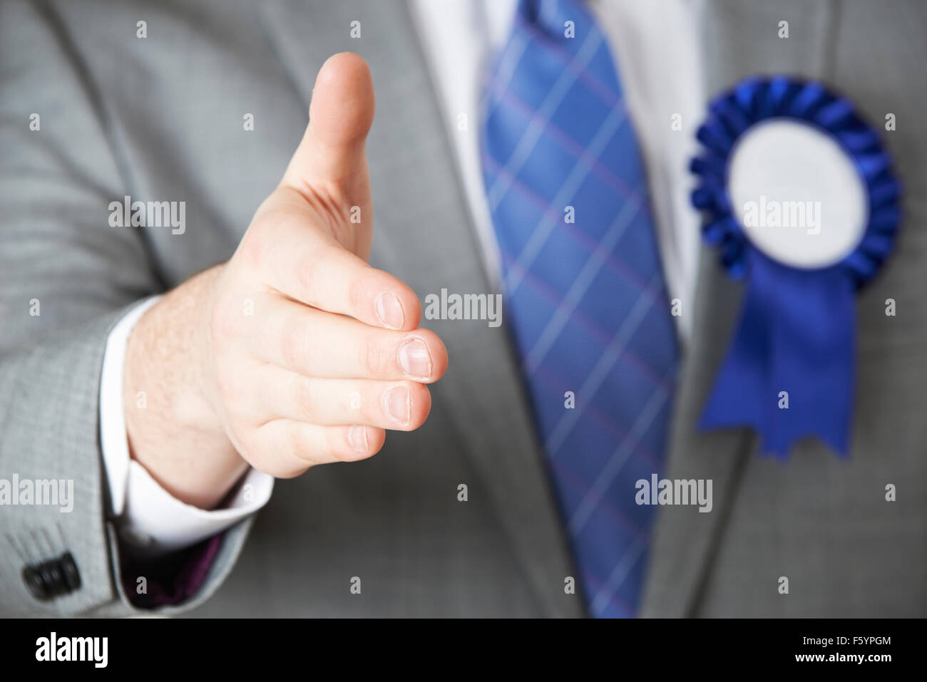 Close Up Of Politician Reaching Out To Shake Hands - Stock Image