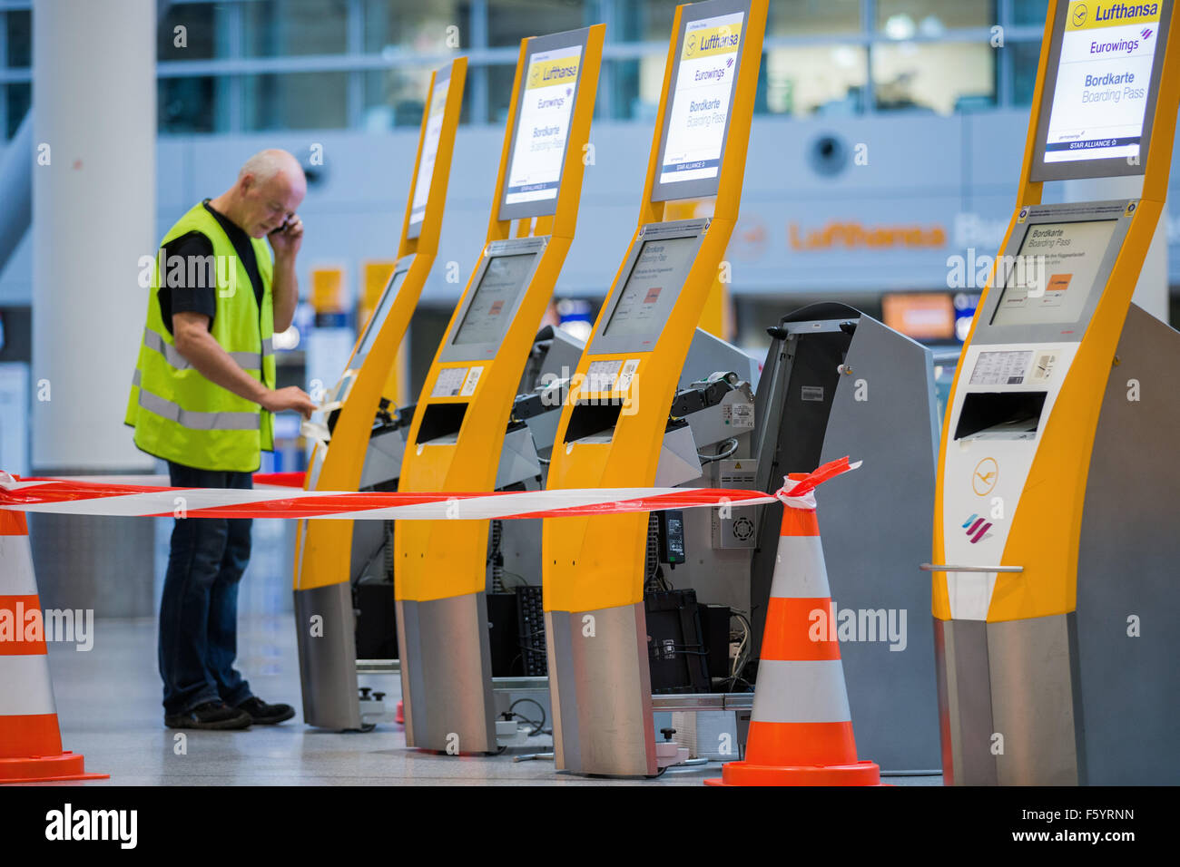 Duesseldorf, Germany. 10th Nov, 2015. Check-in machines are being serviced by maintenance staff at the airport in Stock Photo