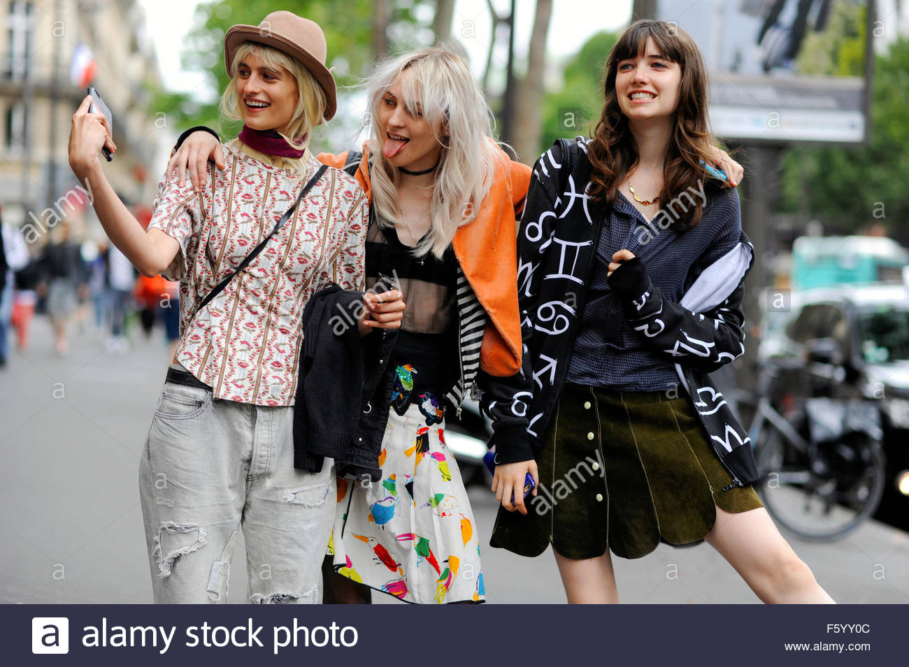 Models Veronika Vilim Lida Fox and Grace Harrtzel having fun with selfies, after Elie Saab Haute Couture, Rue Cambon, - Stock Image
