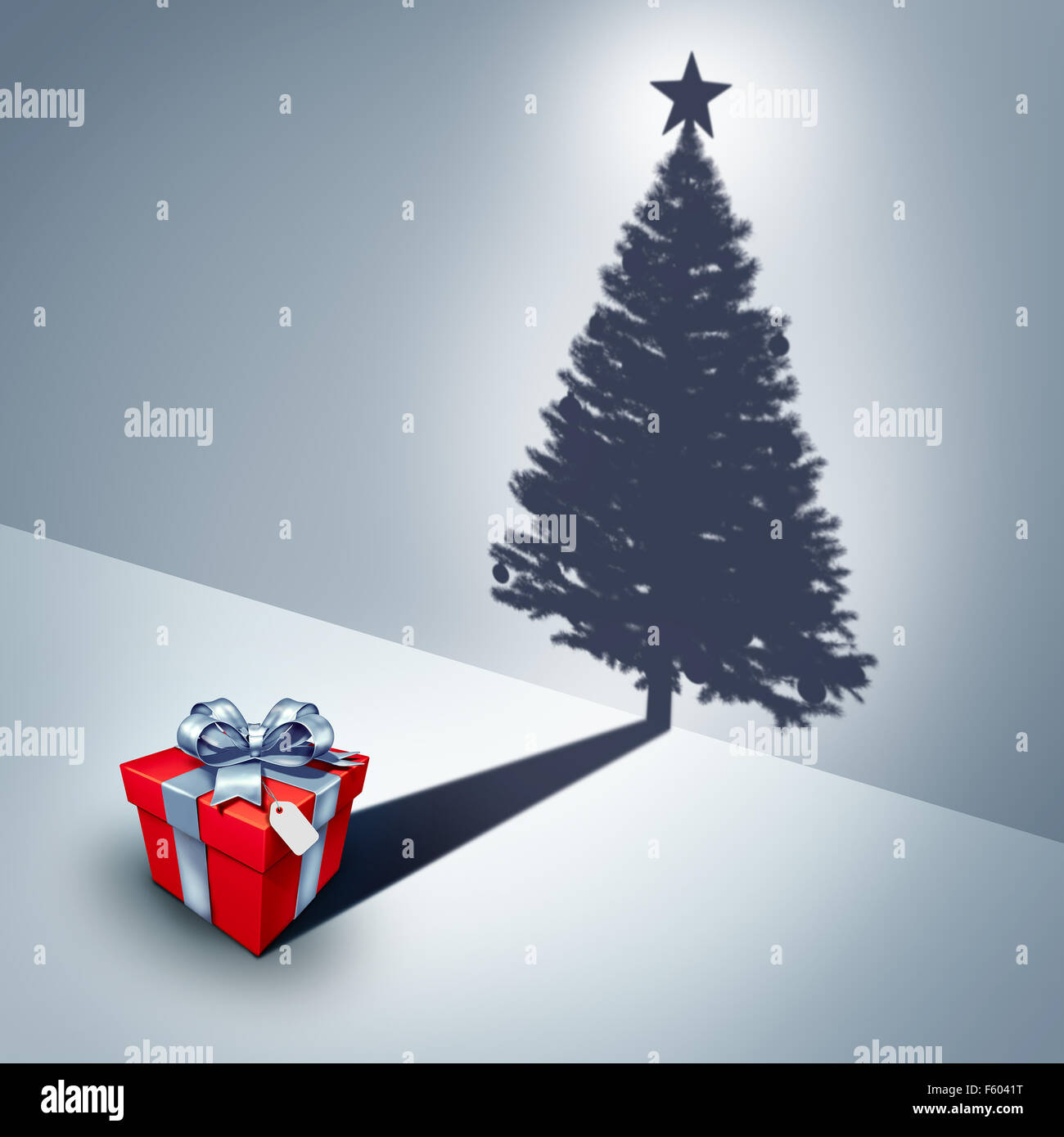 Holiday present dream concept as a gift casting a shadow shaped as a decorated christmas tree as a surreal winter - Stock Image