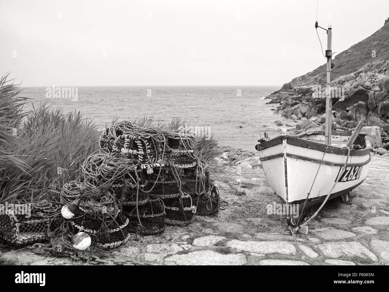 Fishing boat and lobster pots in Penberth cove a hamlet near Penzance in Cornwall coast boats, bay, beach, boats, - Stock Image