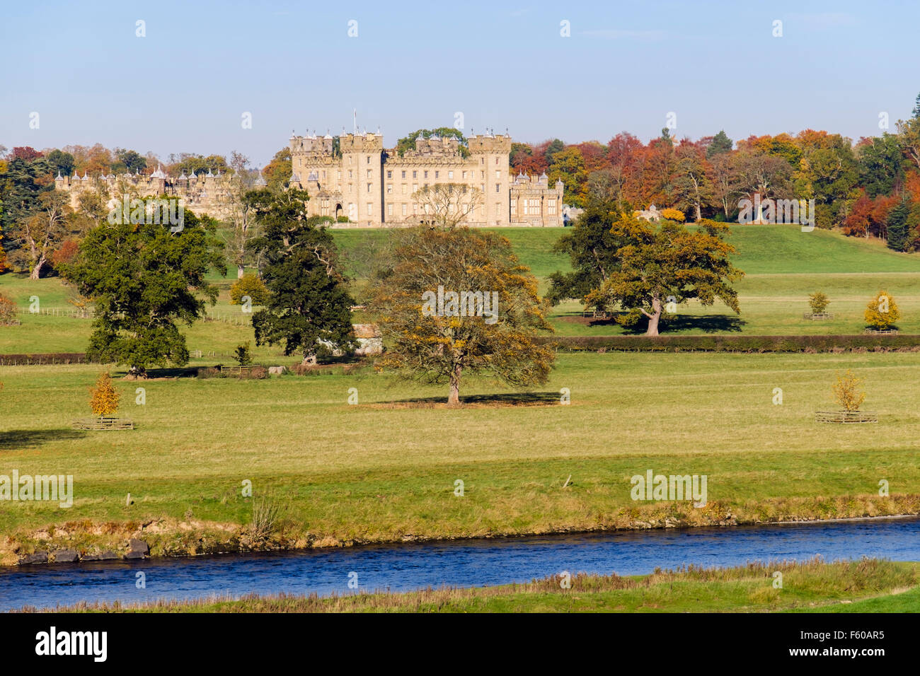 Floors Castle and grounds in autumn from across River Tweed. Kelso, Berwickshire, Scottish Borders, Scotland, UK, - Stock Image