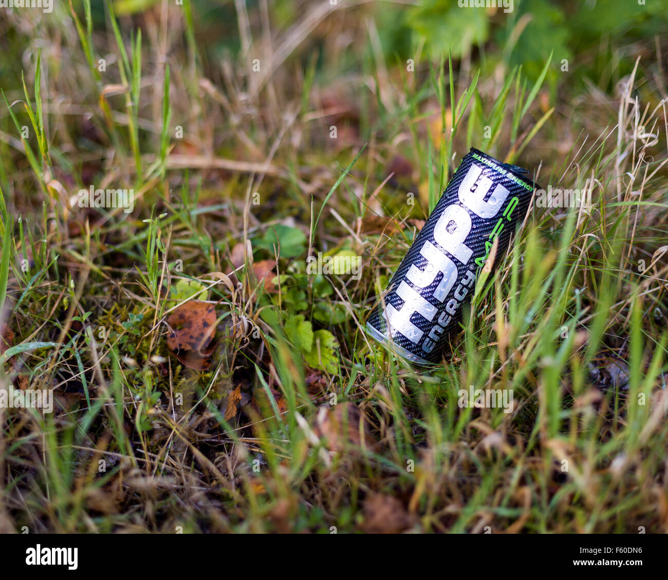 Can of aluminium or aluminum Hype Maximum Energy drink laying discarded as litter in grass  Model Release: No.  - Stock Image