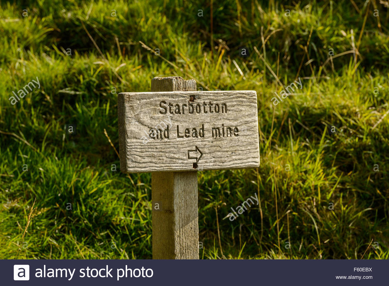 Wood signpost near Buckden, Wharfdale in the Yorkshire Dales, England indicating direction to Starbotton and Lead - Stock Image