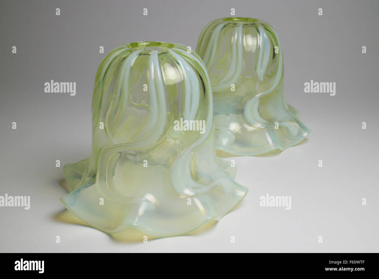 Lamp shades stock photos lamp shades stock images alamy antique pair of art nouveau opalescent glass light lamp shades vaseline stock image mozeypictures Images