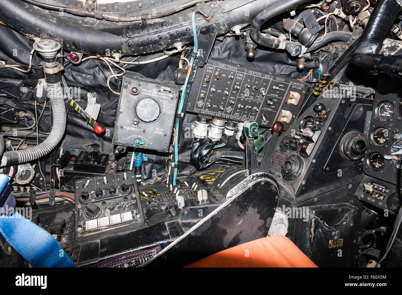 Interior of RAF Canberra bomber showing pilot's seat with front and side control panels. Stock Photo