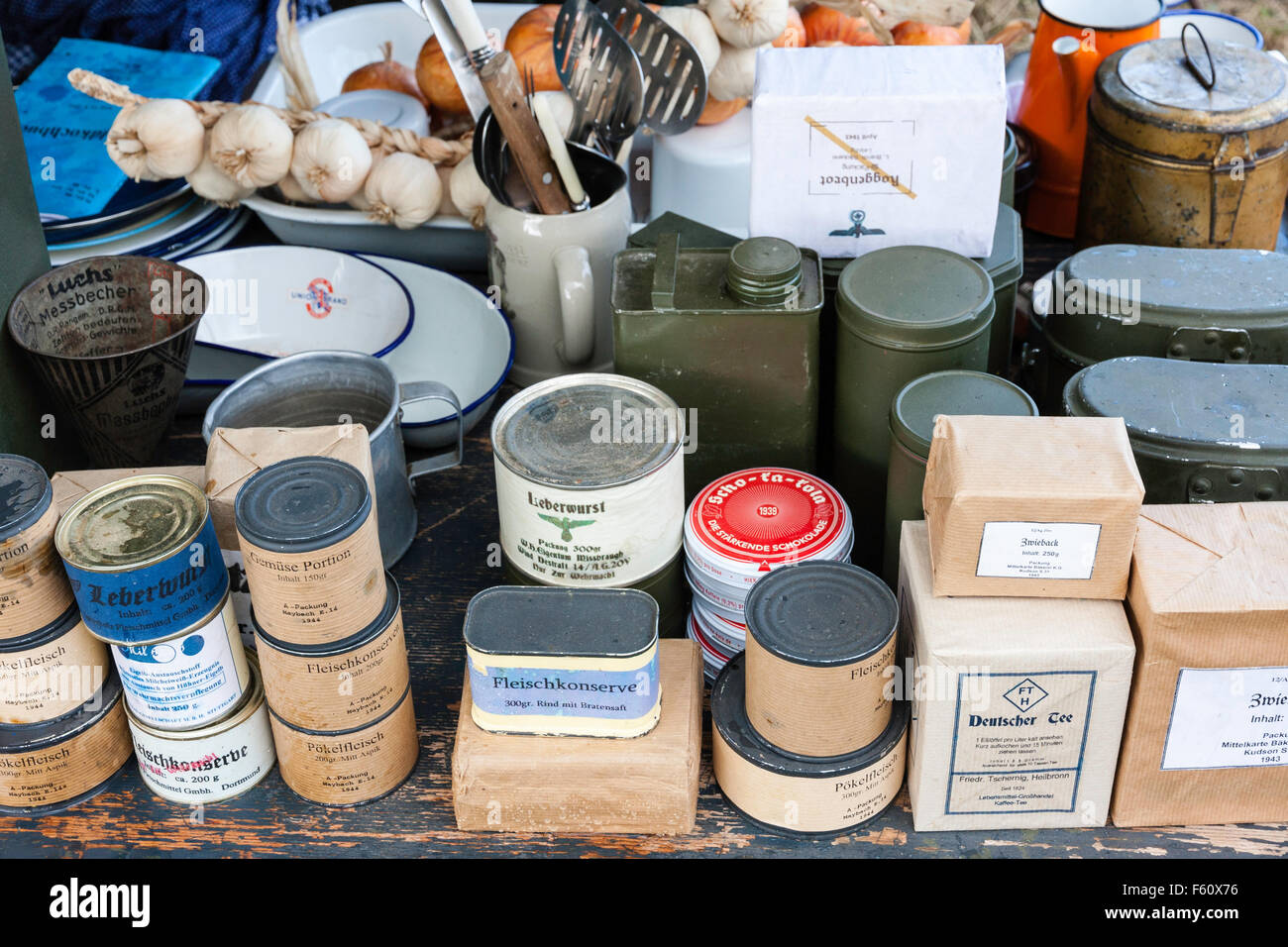 World war two re-enactment. Display of German food field supplies, packets and cans stacked with army labels on. - Stock Image