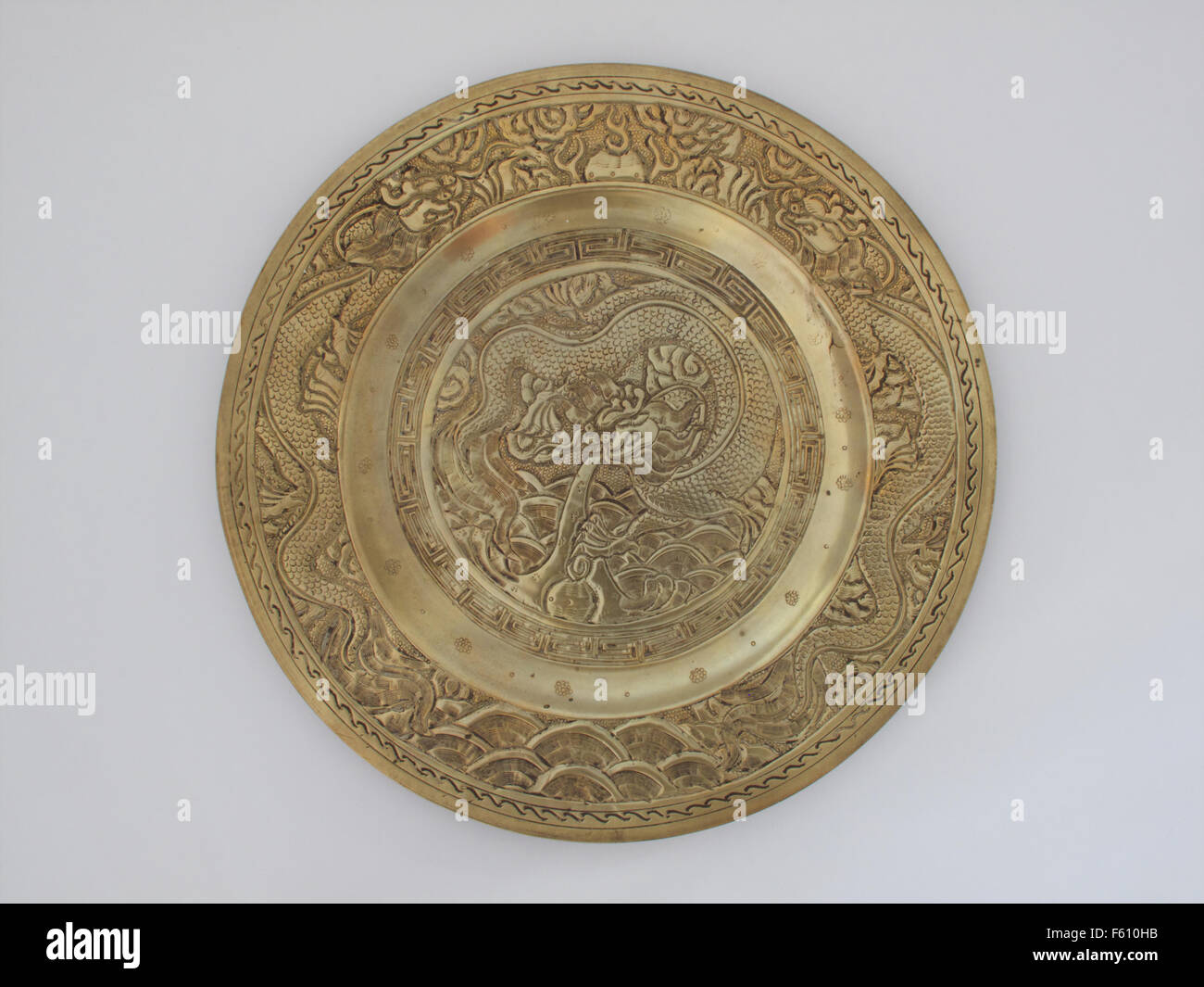 Chinese brass plate incised with a dragon - Stock Image