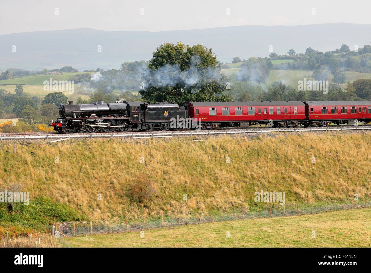 Steam locomotive LMS Jubilee Class Leander 45690 on the Settle to Carlisle Railway Line near Lazonby, Eden Valley, - Stock Image