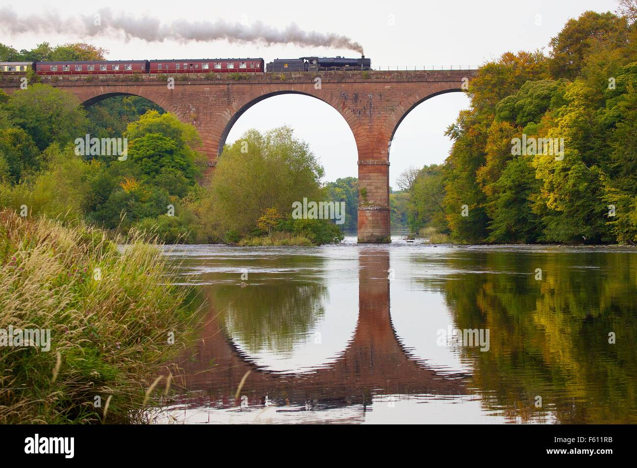 Steam locomotive LMS Jubilee Class Leander 45690. Wetheral Viaduct Eden, Wetheral, Carlisle, Cumbria, UK. - Stock Image