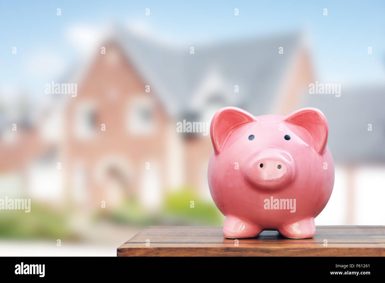 Saving to buy a house - Stock Image