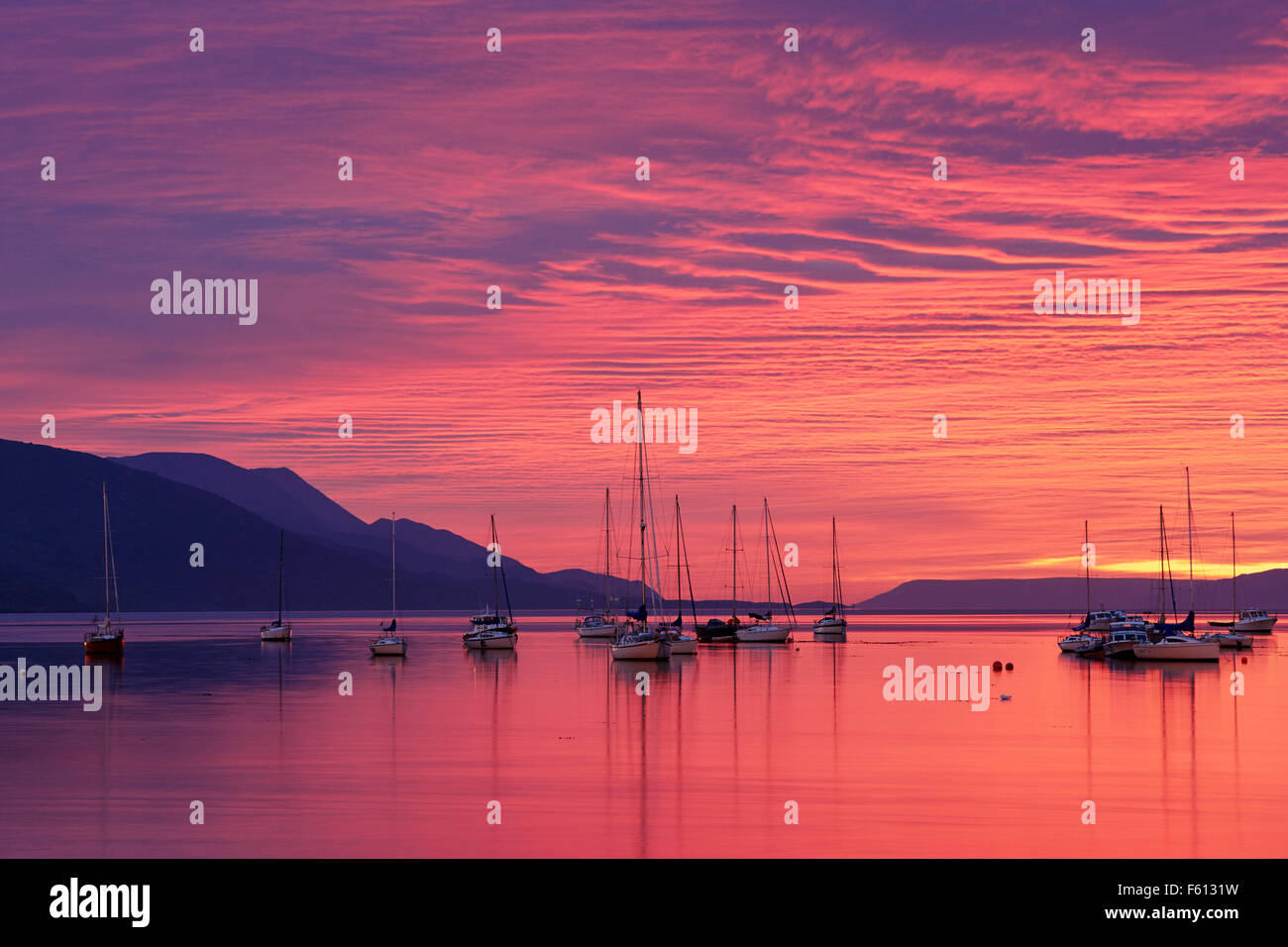 Sailing boats in harbour at sunset, Ushuaia, Tierra del Fuego, Argentina - Stock Image