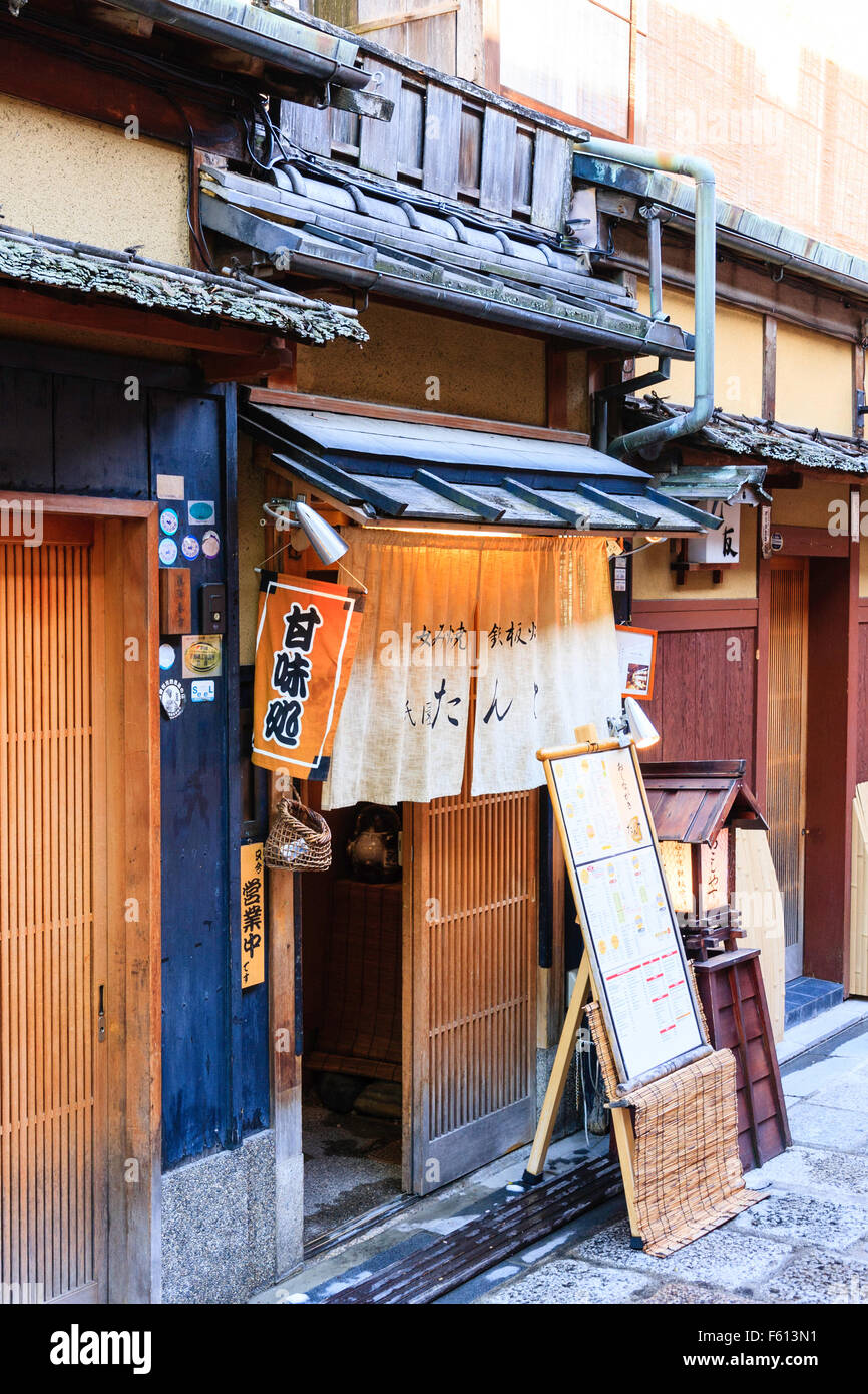 Japanese Traditional Wooden Bar With Sliding Door And Noran Curtains  Hanging. Mushiko Window And Koshi, Latticework.