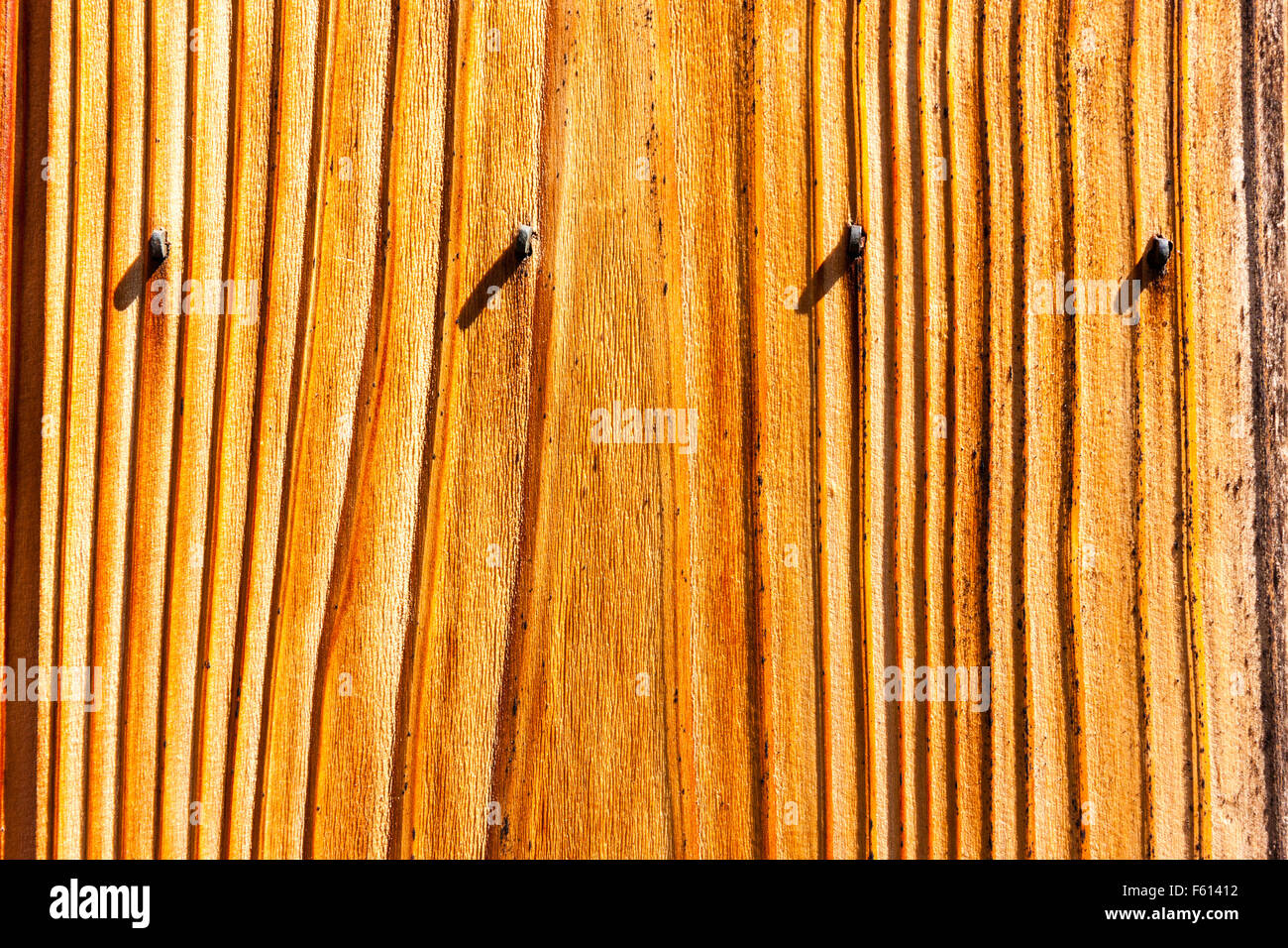 Japan, Kyoto, Gion. Texture. Detail of traditional wooden fence with nails protruding above the wooden boards in - Stock Image