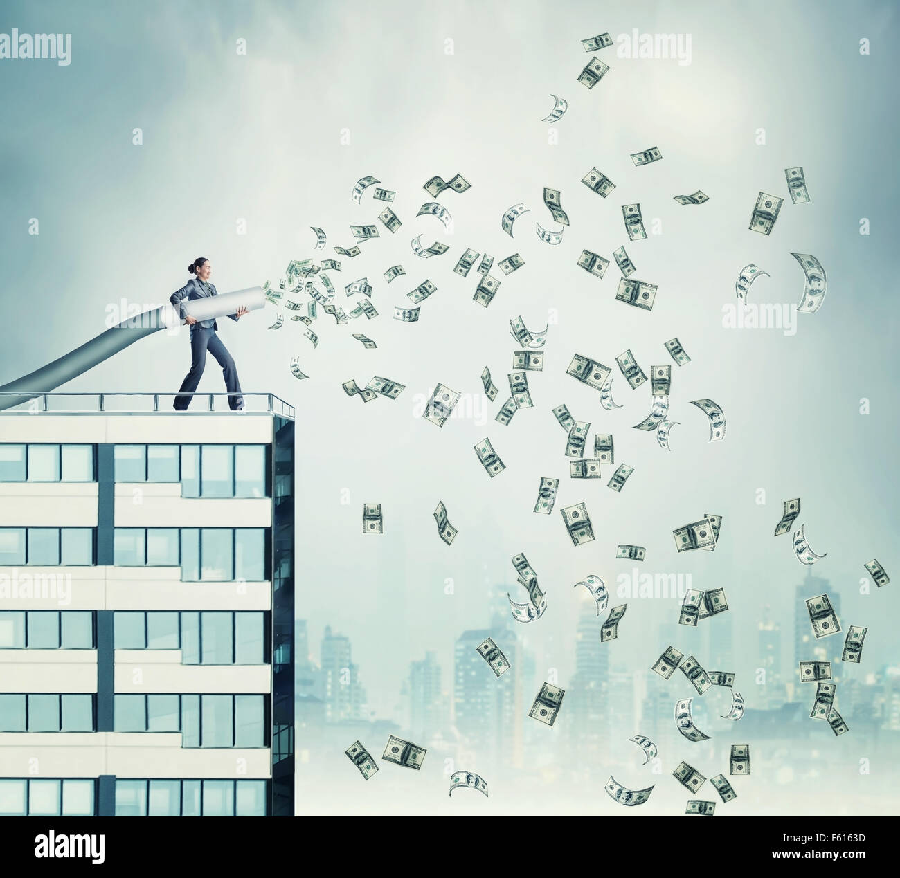 Woman standing on the skyscraper funds dollars - Stock Image