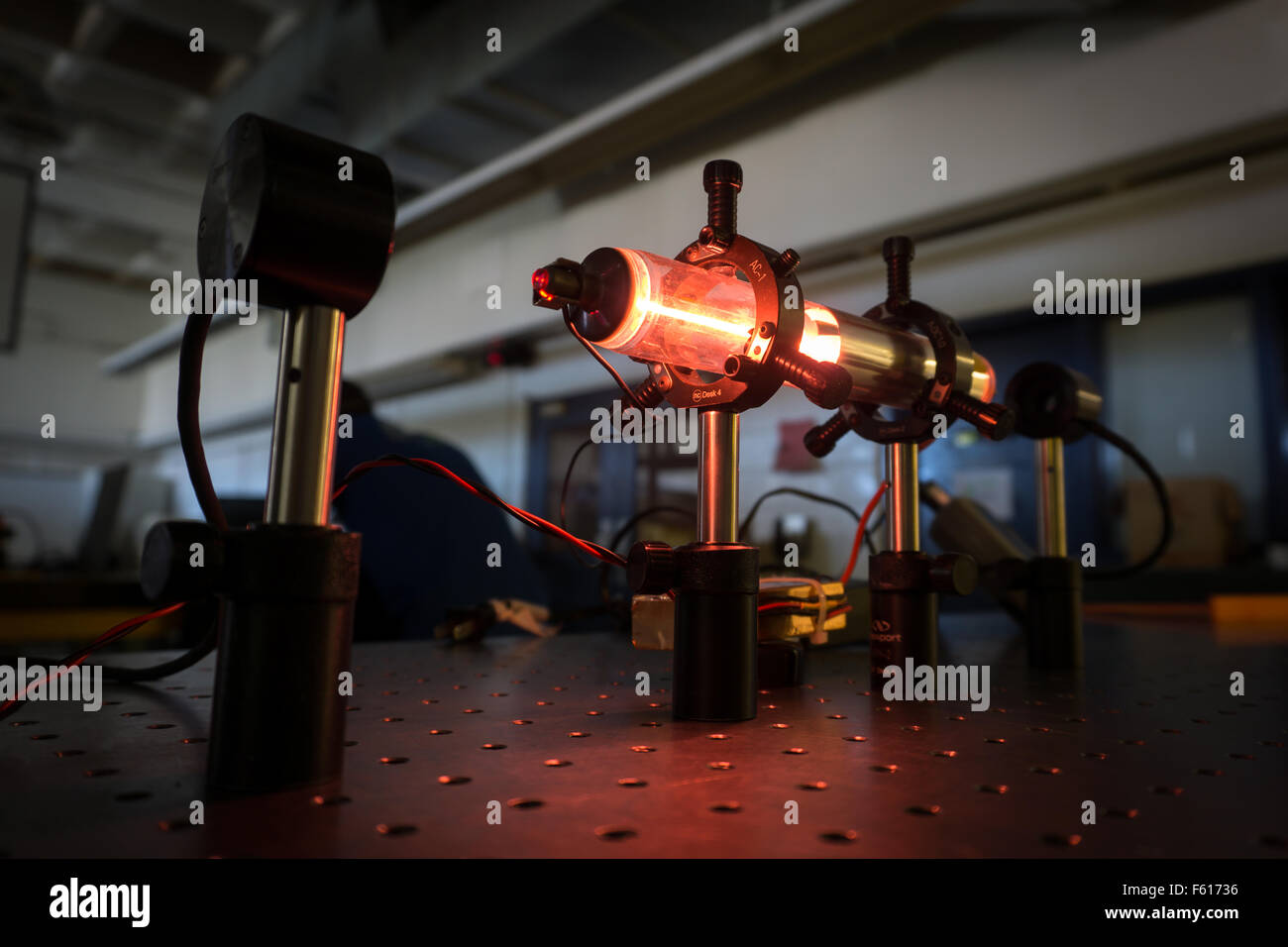 A HeNe laser on an optics bench. - Stock Image