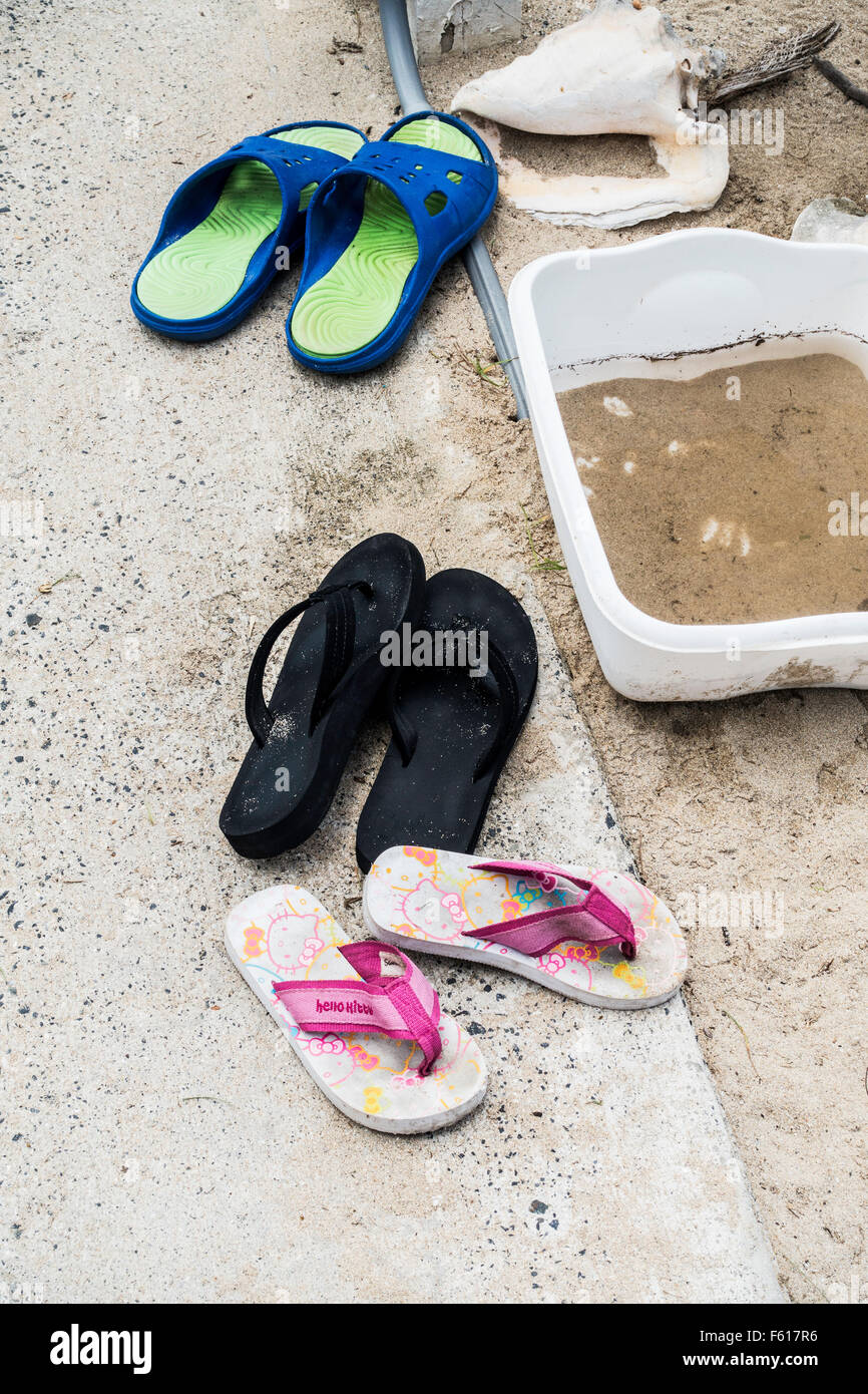 54f2e1908dcc Flip-flops or beach shoes lined up near the entrance to a Caribbean beach in
