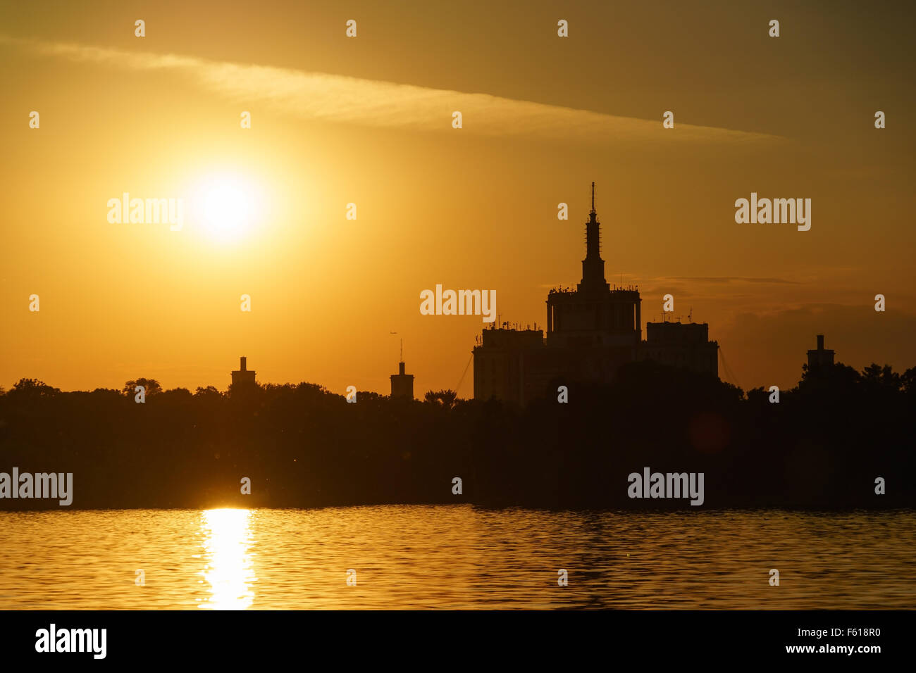 Sunset over Casa Sciintei and the lake at Herastrau Park in Bucharest, Romania. - Stock Image