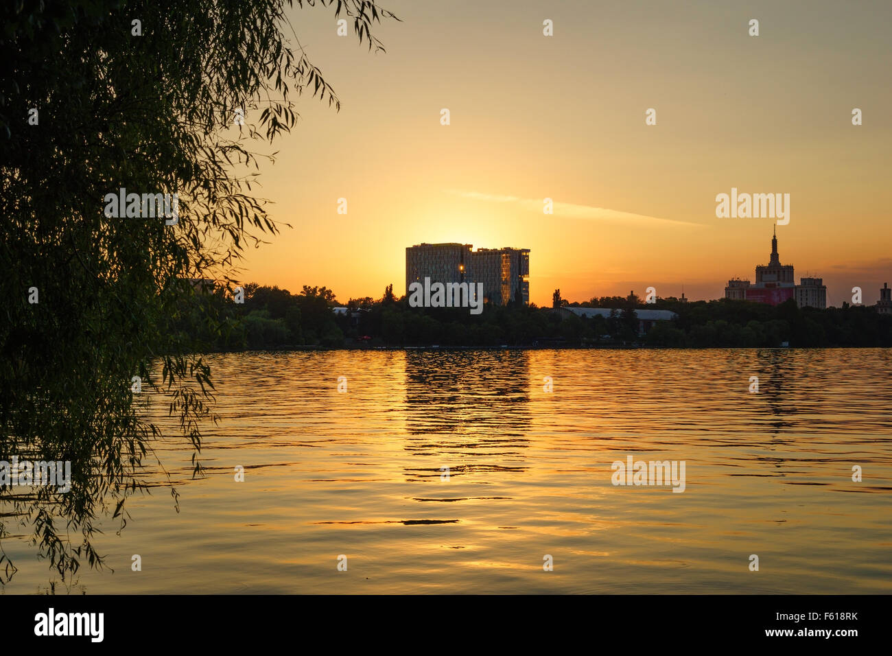 Sunset over the lake at Herastrau Park in Bucharest, Romania. Stock Photo
