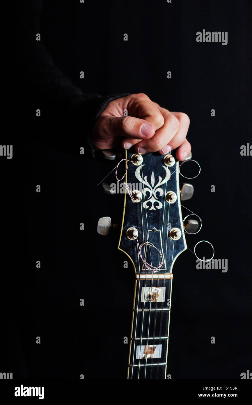 Human hand on guitar - Stock Image