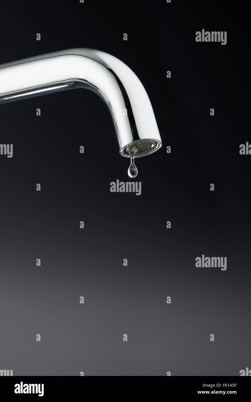 Tap with Water Drip Stock Photo