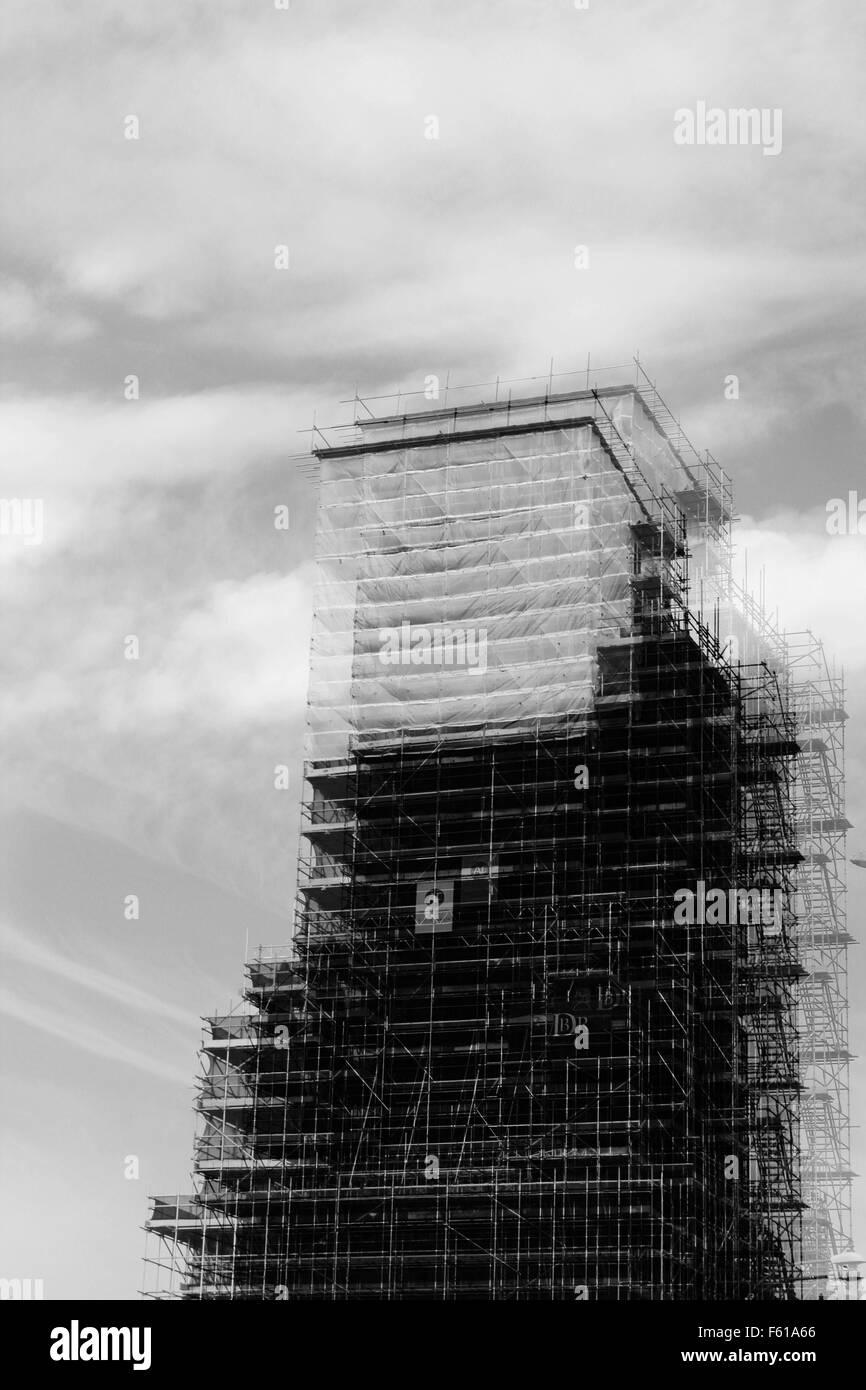 scaffolding surrounding a church - Stock Image