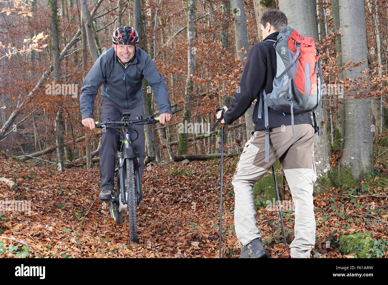 A Hiker meetin a mountain biker - Stock Image
