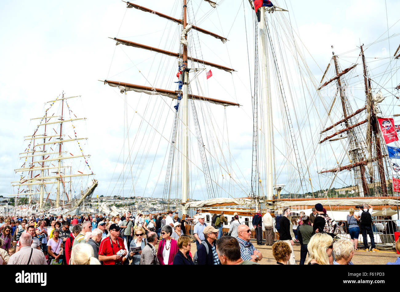 """Crowds admire the vessels at the """" Tall Ships """" event in Falmouth, Cornwall, UK Stock Photo"""