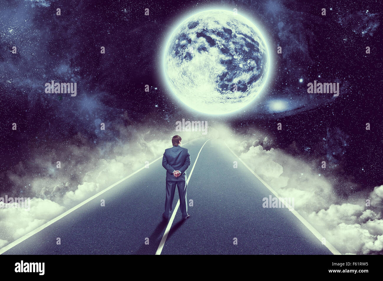 Businessman standing back on the road in space - Stock Image
