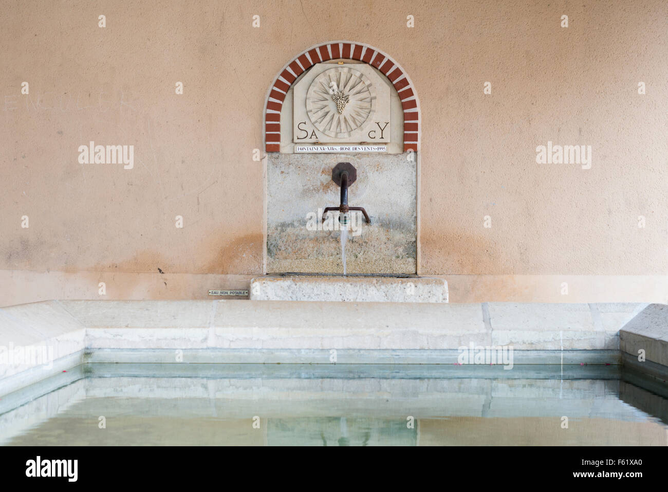 A tap and drinking water fountain in the town of Sacy, Champagne France - Stock Image