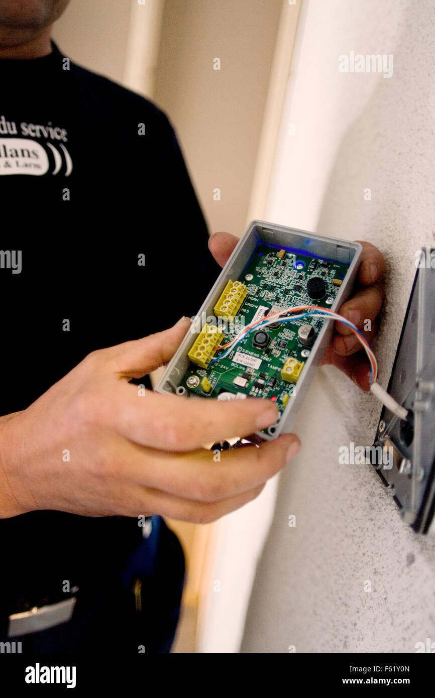 Man repairing access control system - Stock Image