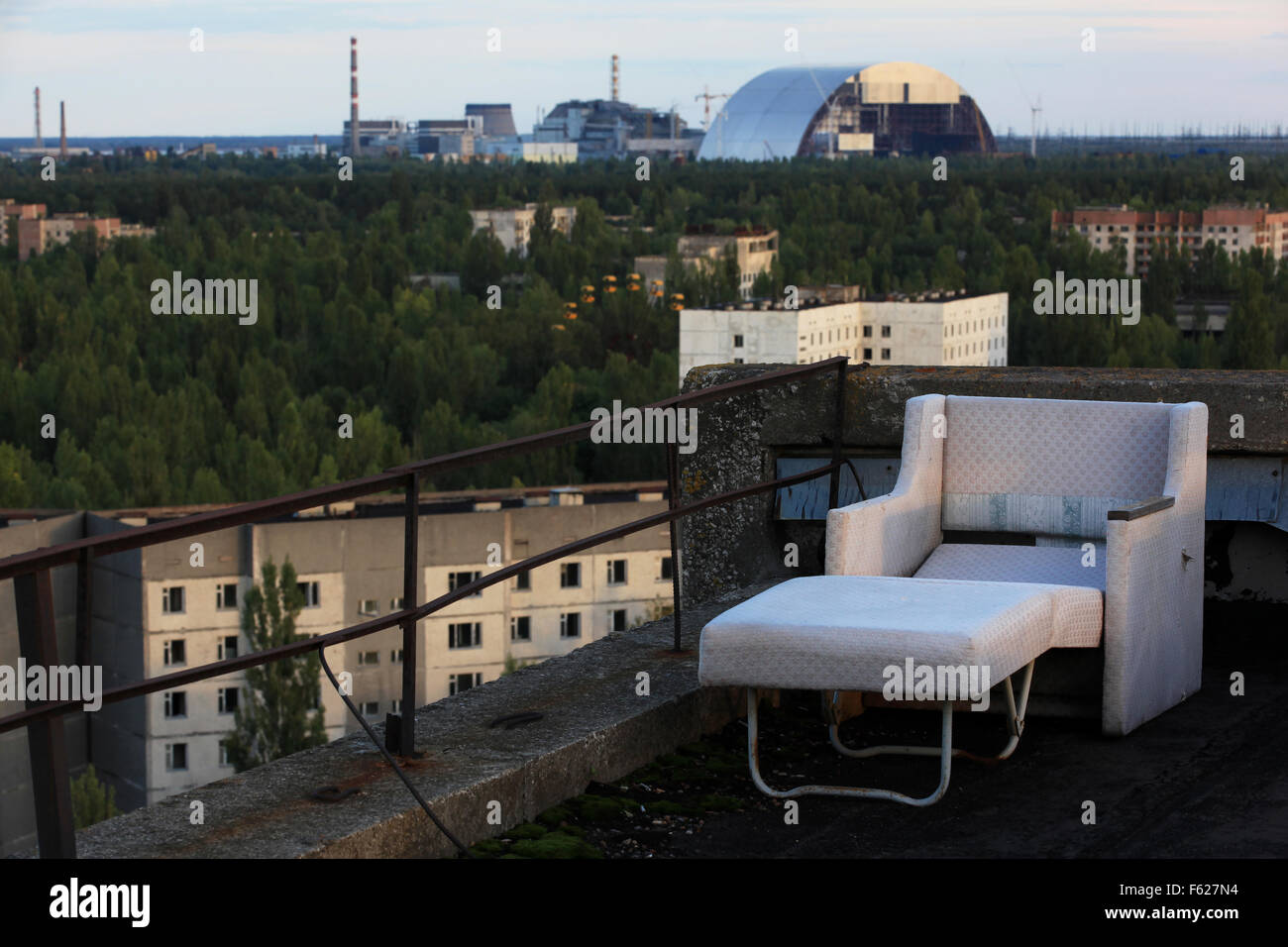 The abandoned town of Pripyat and the nearby Chernobyl Nuclear Power Plant seen from the roof of a high-rise building. - Stock Image