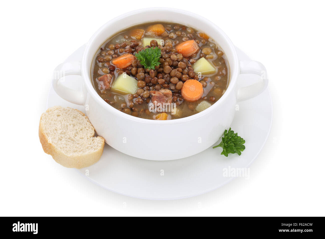 Lentil soup stew meal with lentils in cup isolated on a white background Stock Photo