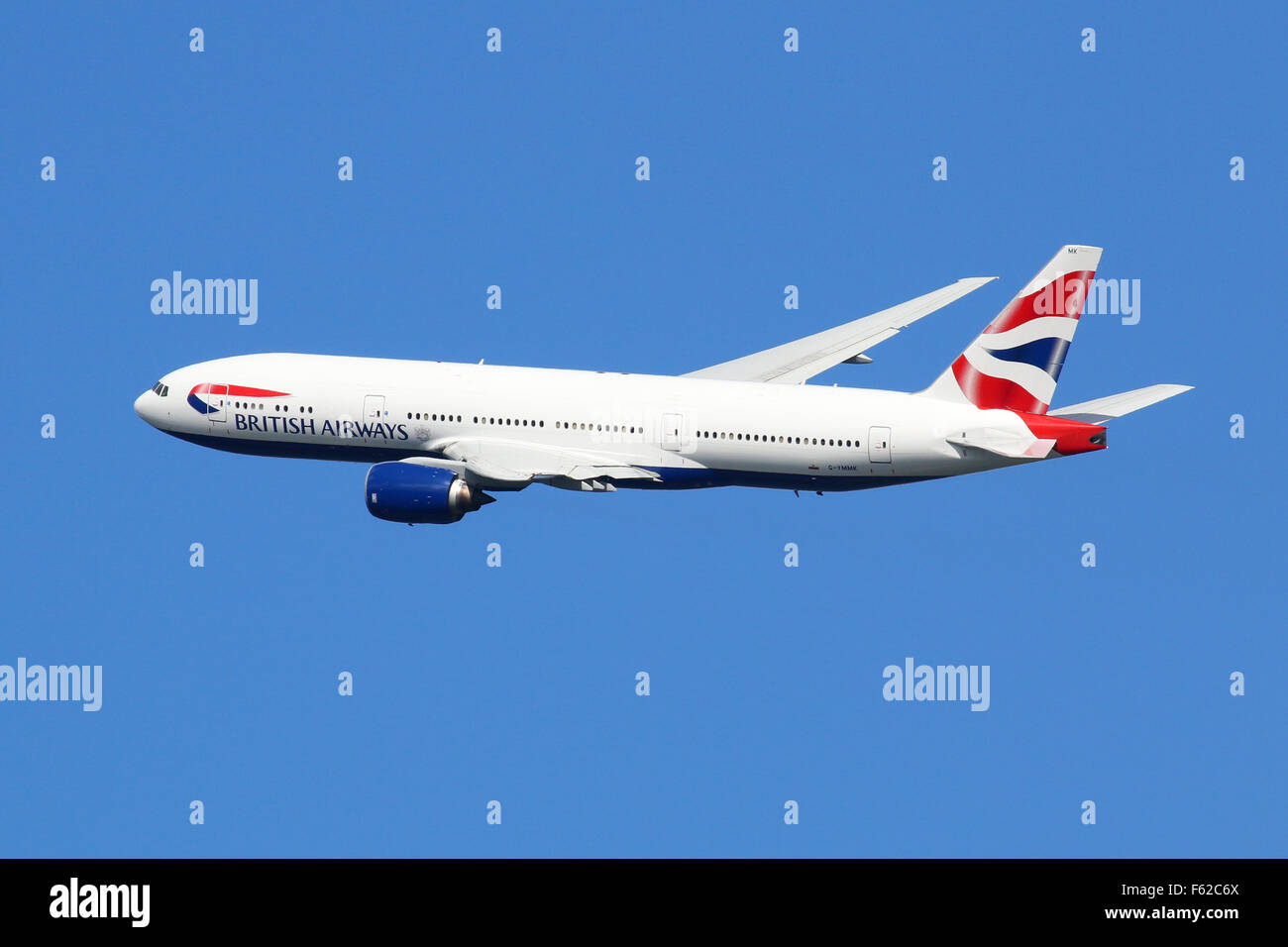 London Heathrow, United Kingdom - August 28, 2015: A British Airways Boeing 777 with the registration G-YMMK taking - Stock Image
