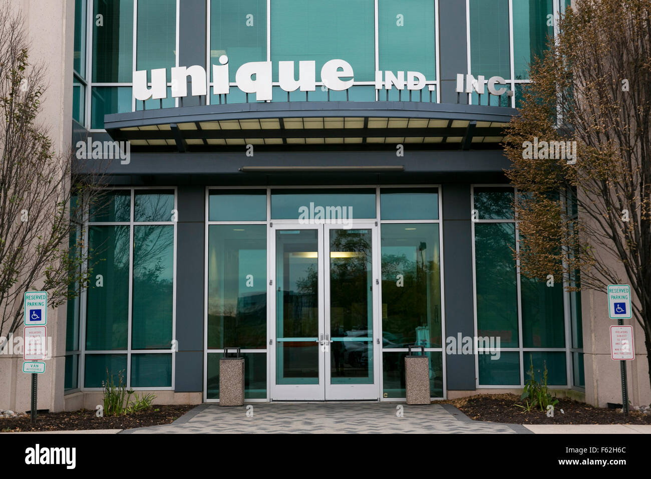 A logo sign outside of the headquarters of Unique Industries, Inc., in Philadelphia, Pennsylvania on November 7, - Stock Image