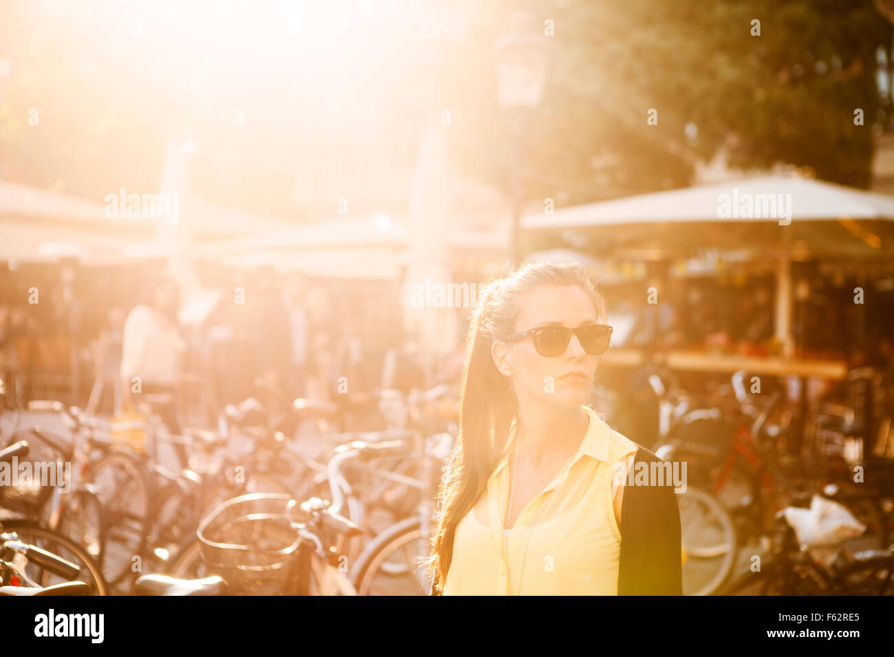 Beautiful young woman wearing sunglasses in city Stock Photo