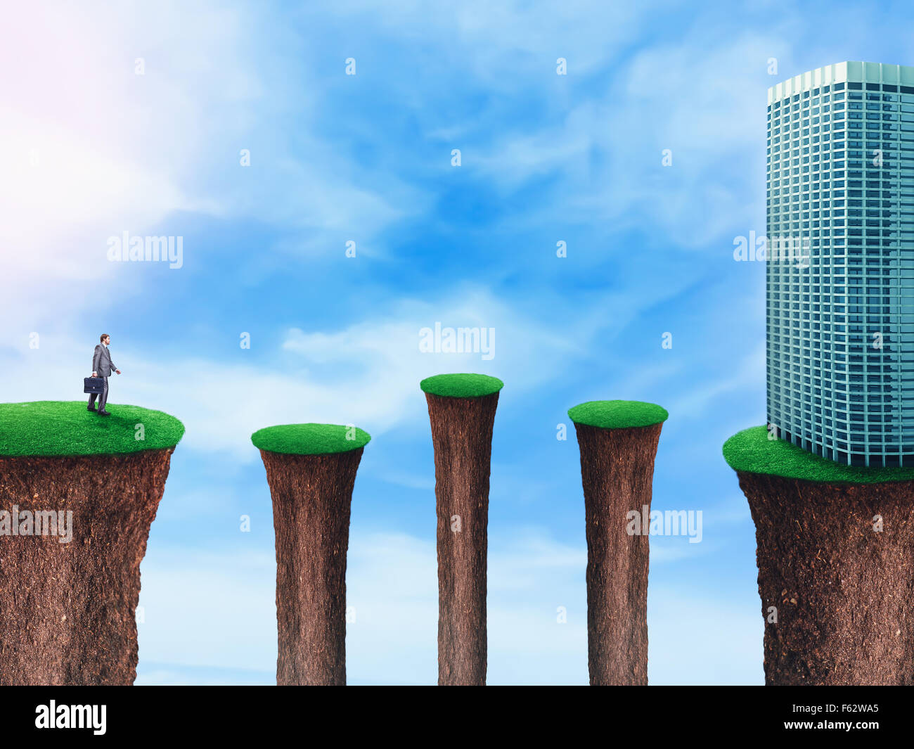 Businessman stepping up on the separated grass hills to the office building - Stock Image