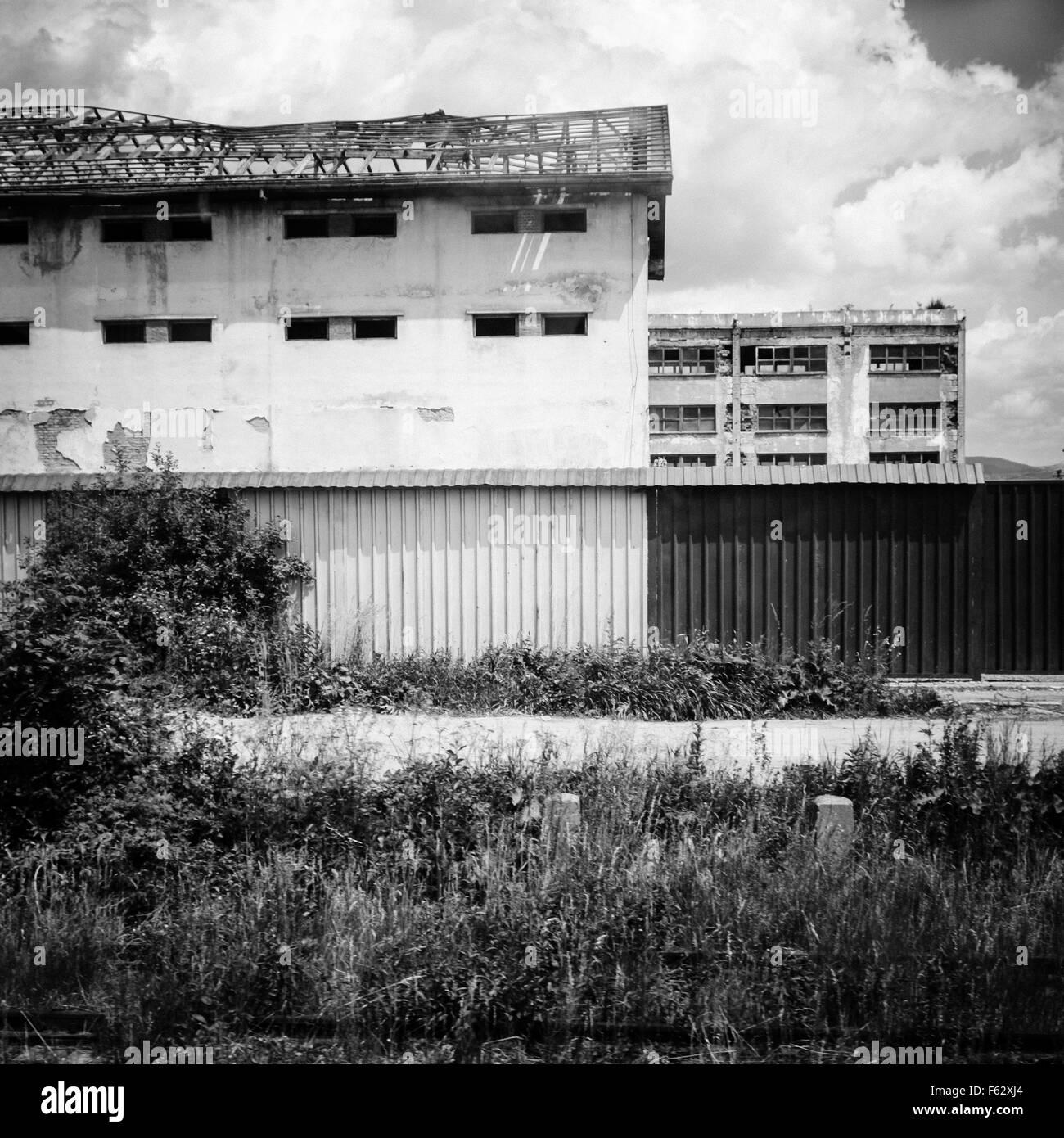 Post-industrial black and white landscape. Industrial buildings in nature. Miercurea Ciuc, Harghita County, Romania. - Stock Image
