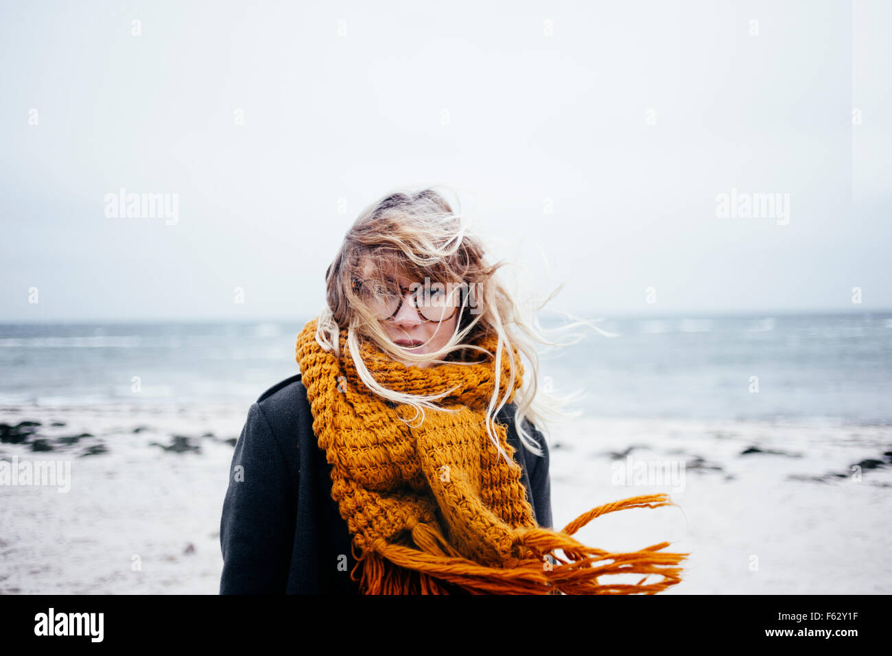 Portrait of young woman with tousled hair at beach Stock Photo