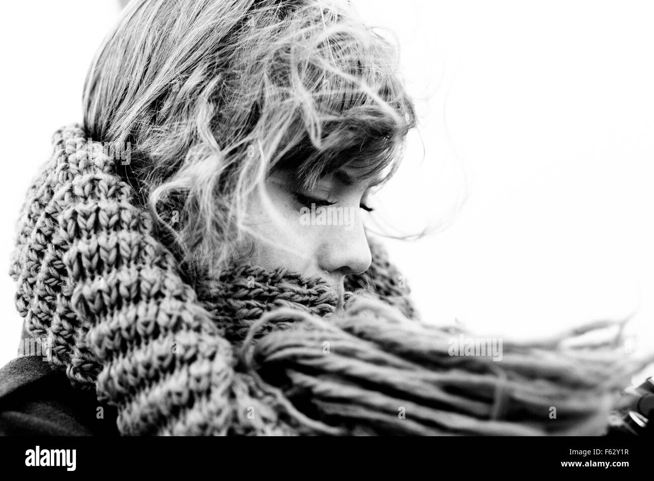 Close-up of young woman wearing scarf outdoors - Stock Image