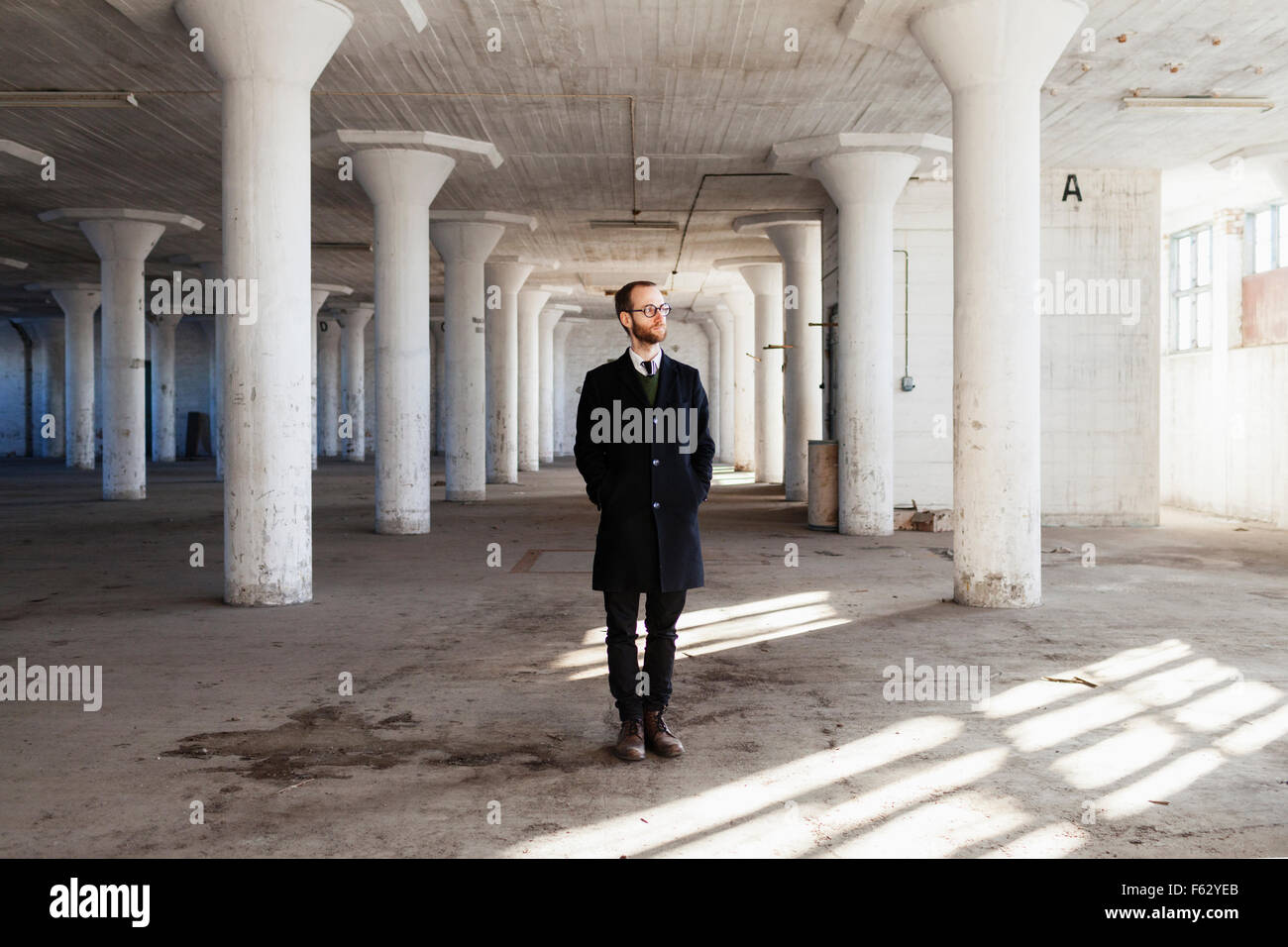 Lonely Businessman In Abandoned Building Stock Photo Alamy