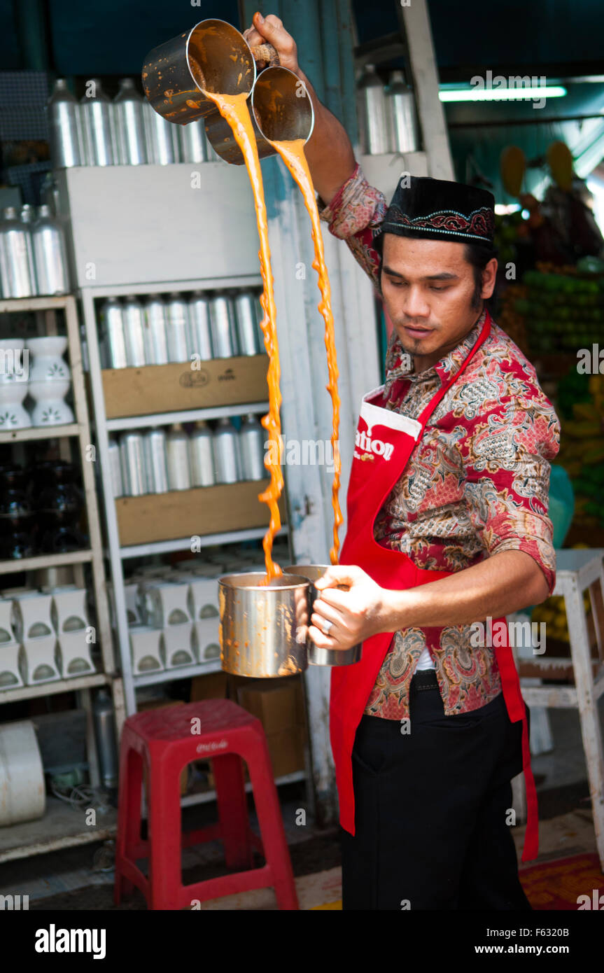 Vendor blending Thai Spiced Iced Tea at Chatuchak Weekend Market , Bangkok , Thailand. - Stock Image