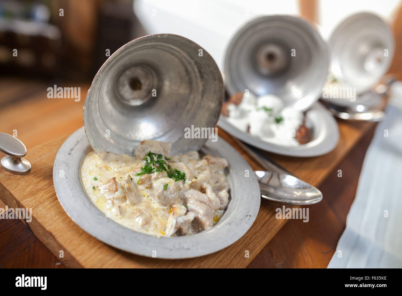 Traditional Bosnian dishes (L-R) Hadzijski cevap / Veal (Seasoned veal and fresh mushroom chops in white sour cream - Stock Image