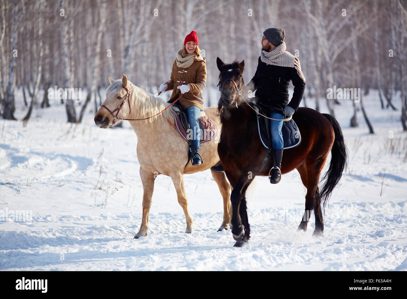 Happy Couple Horse Riding In The Forest Stock Photo Alamy